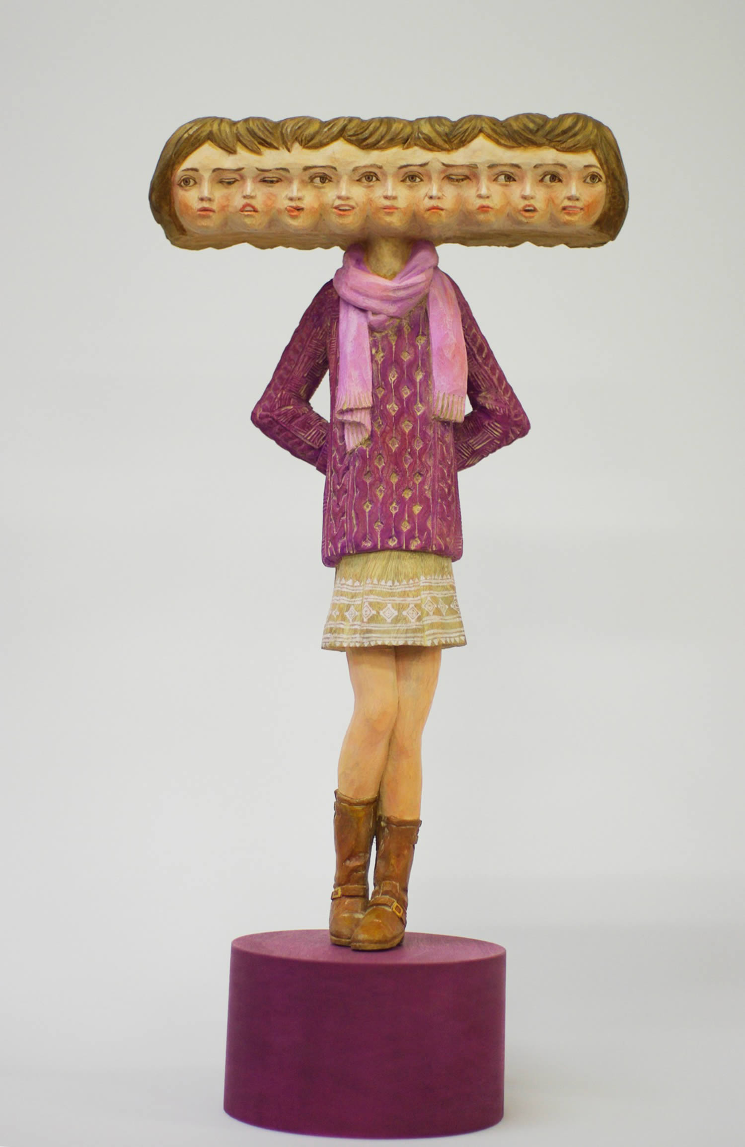 girl with big head, repeated heads sculpture