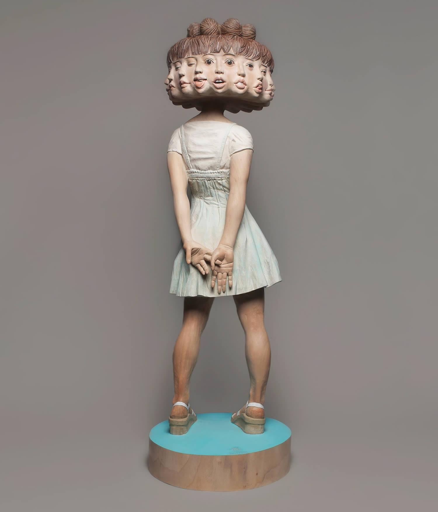 rotating head girl sculpture
