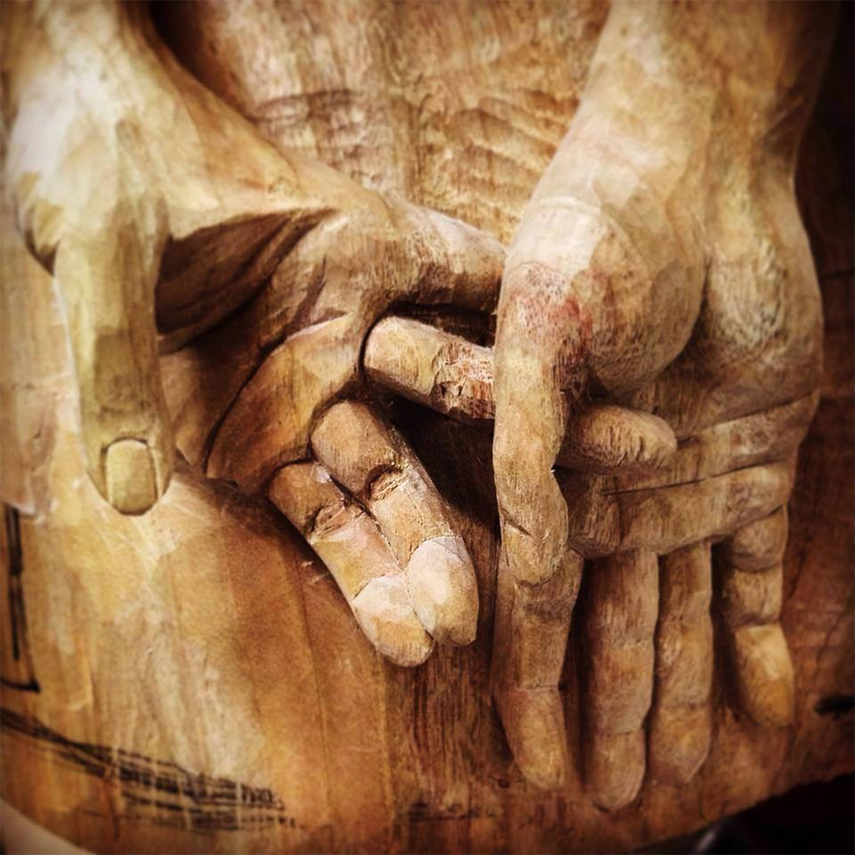 wood sculpture detail of hands