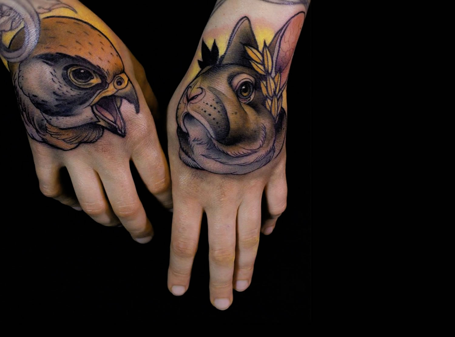 hawk and rabbit hand tattoos by Daniel Gensch