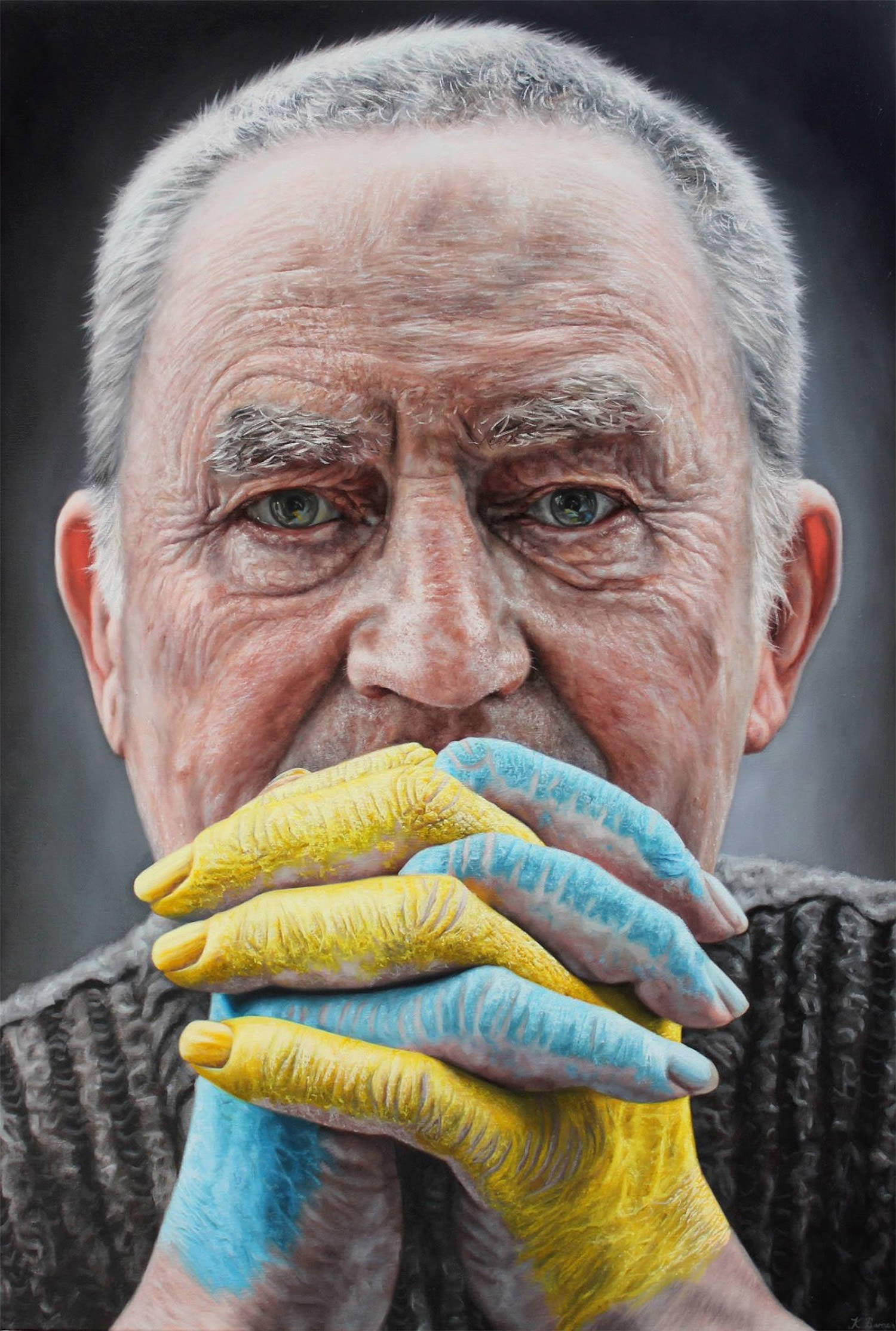 man with yellow and blue hands, painting