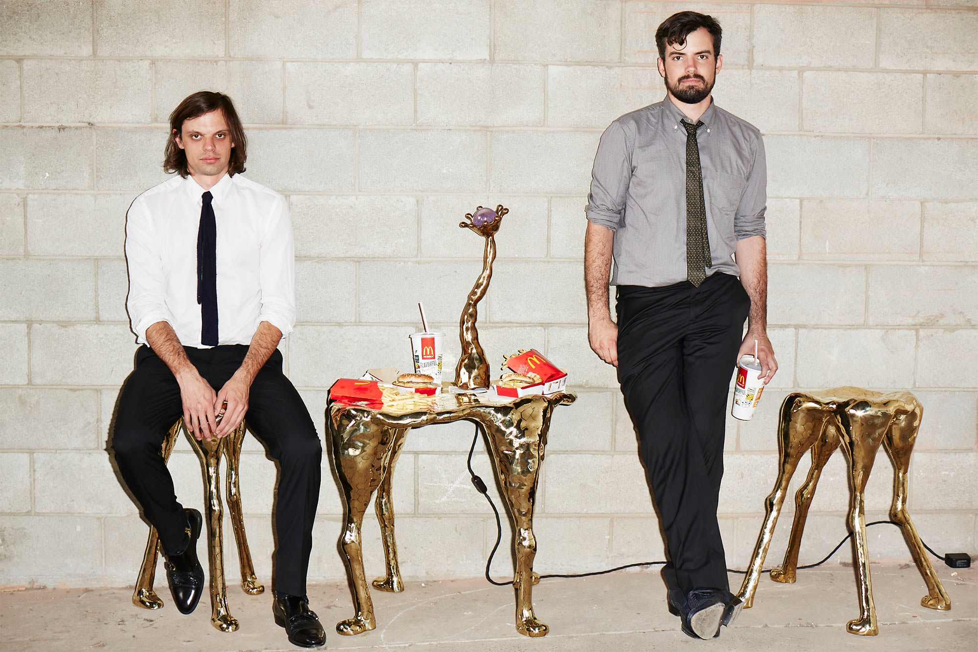 The Haas Brothers posing with furniture