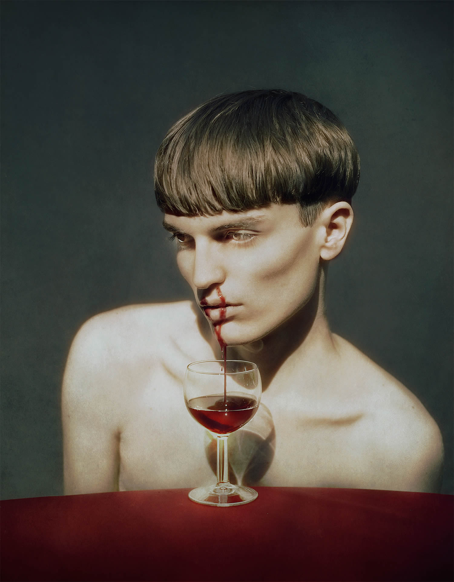 blood coming out of boy's nose to a glass wine, by Marwane Pallas