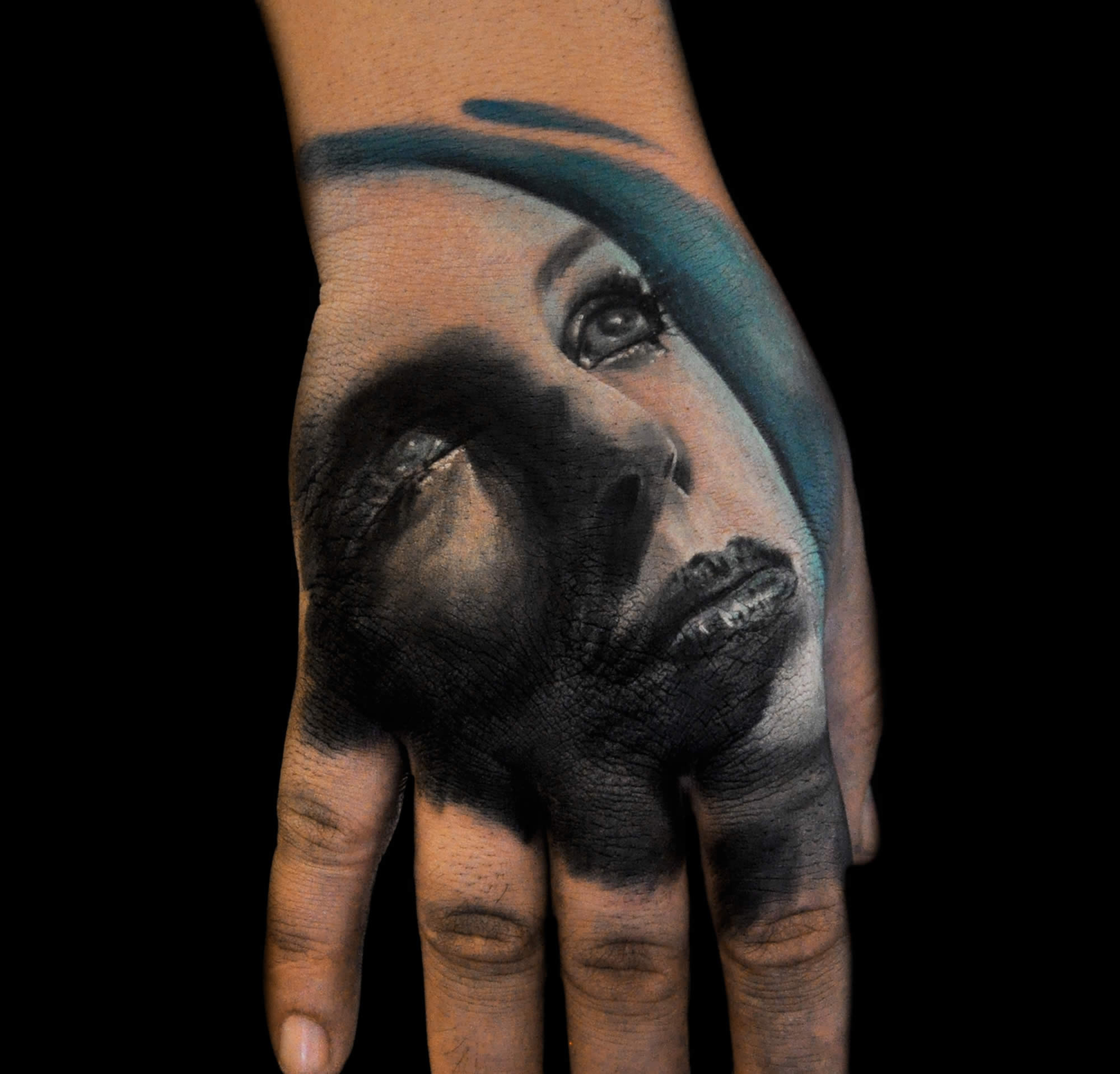 portrait of woman on hand, hand tattoo