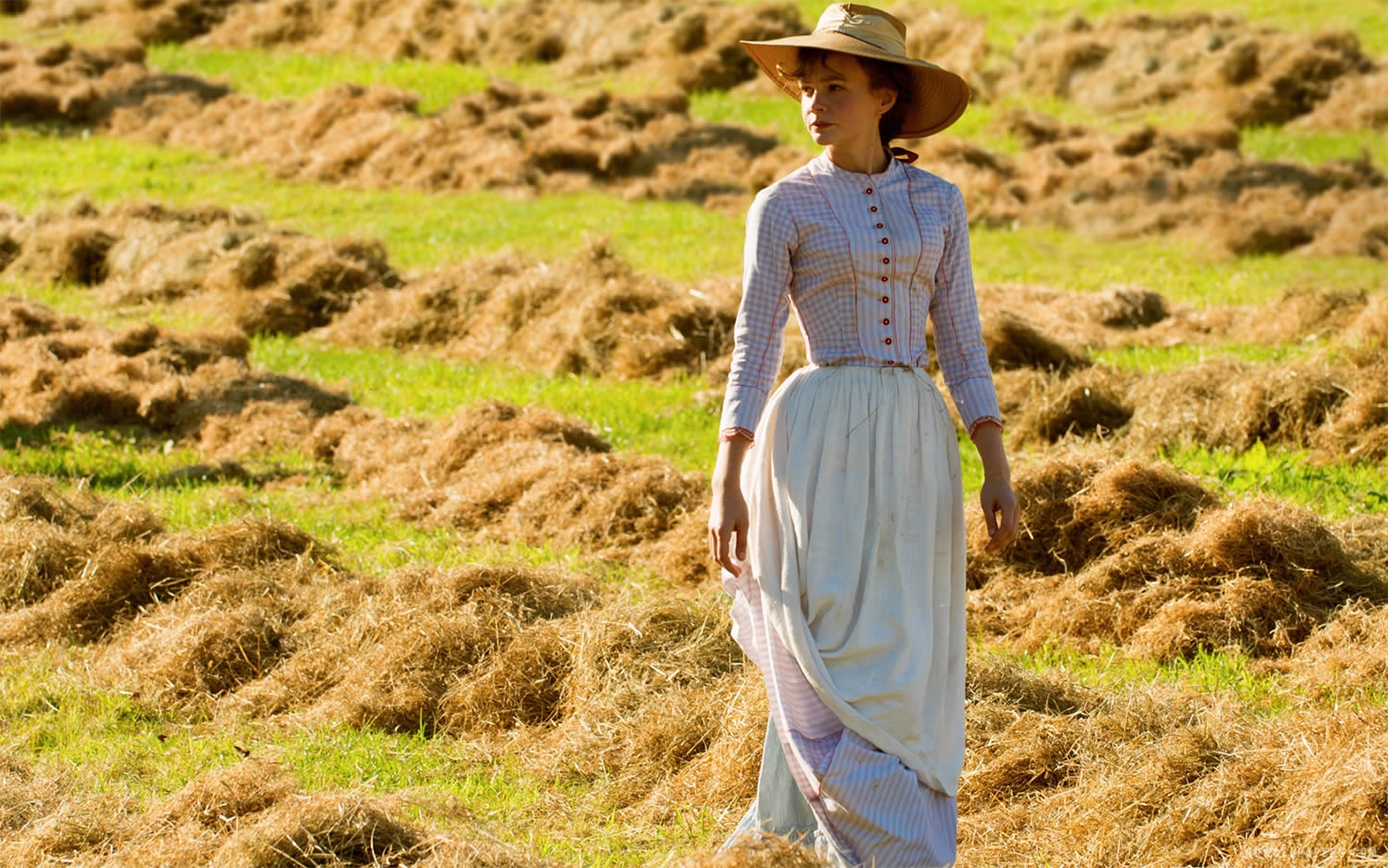 carey mulligan walking in field inFar from the Madding Crowd