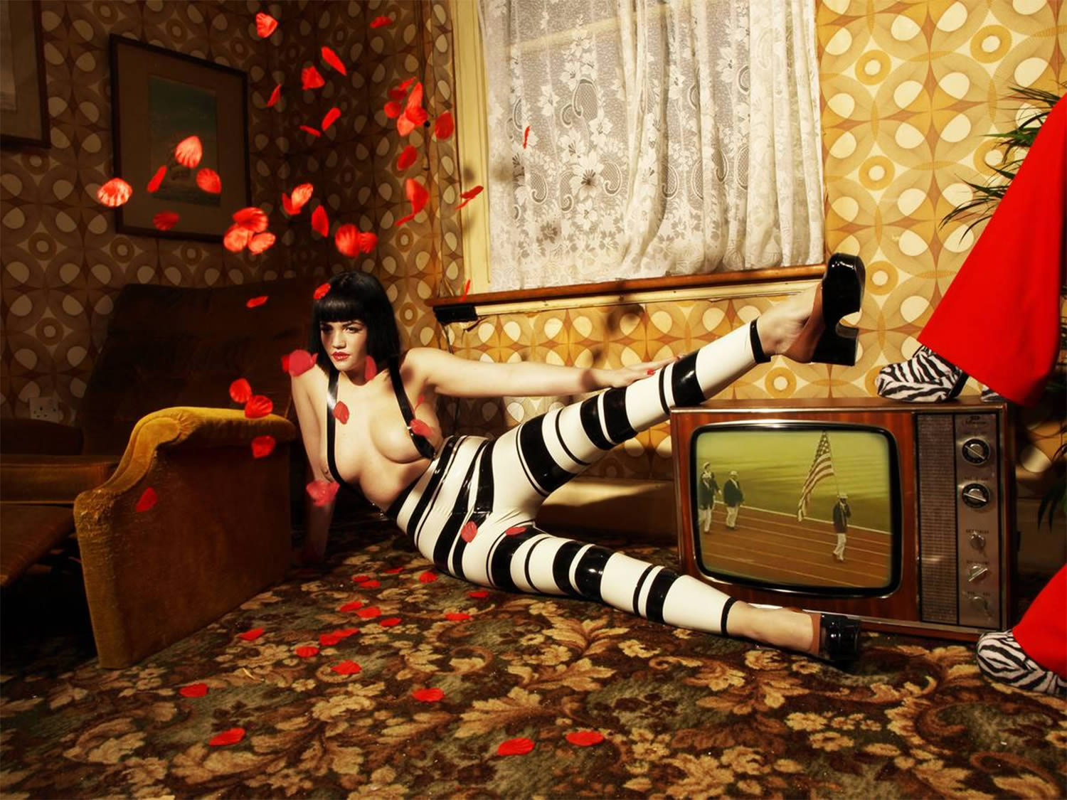 woman with striped paints in living room, by nadia lee cohen