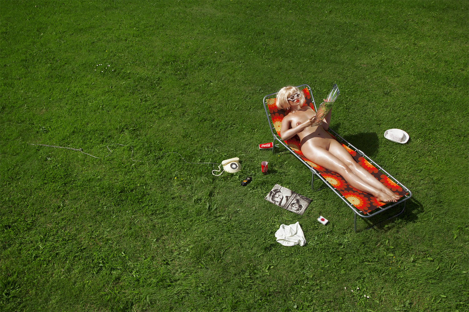 woman on sun bathing chair on grass lawn, by nadia lee cohen