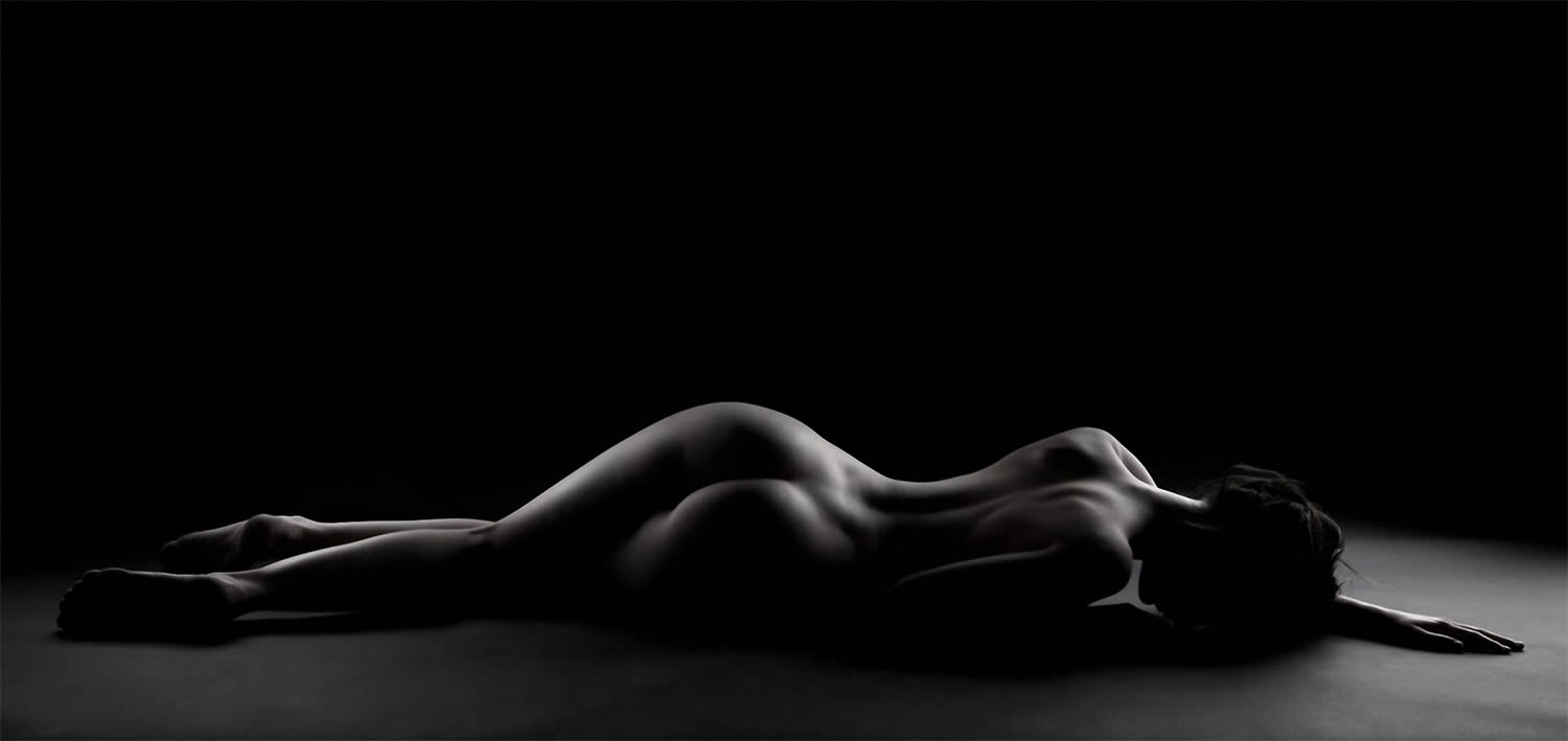 woman lying down, nude photo by joel bloch