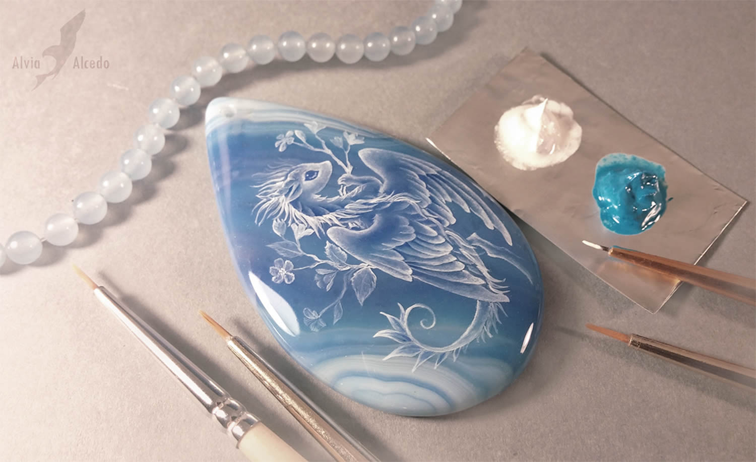 white dragon on blue stone
