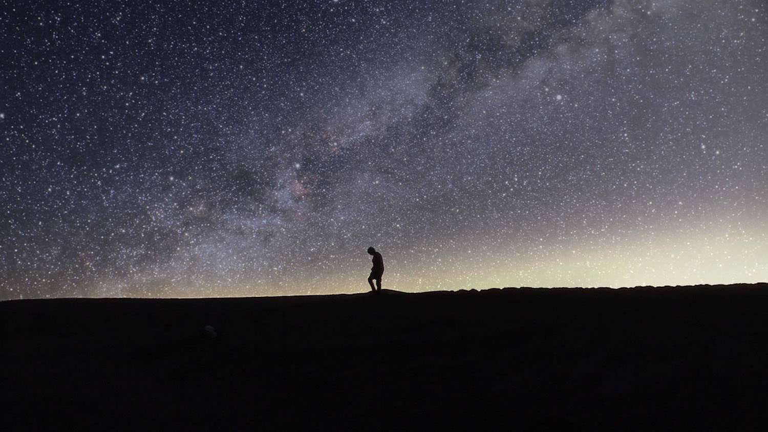 milkyway and silhouette of man in field, Nostalgia for the Light