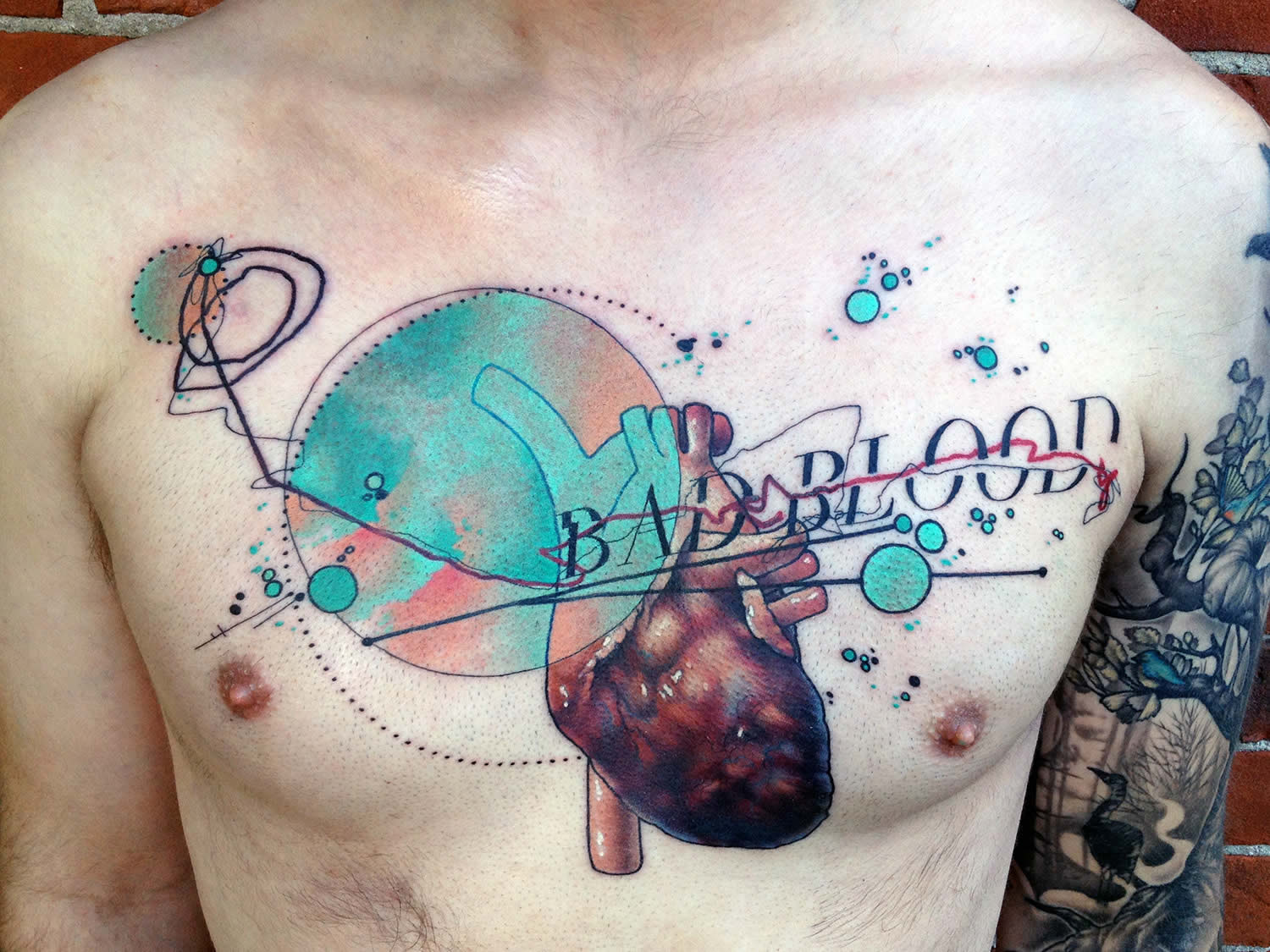 bad blood, heart tattoo on chest by cody eich