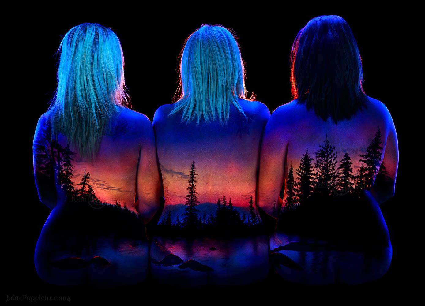sunset, uv body painting, black light art by john poppleton