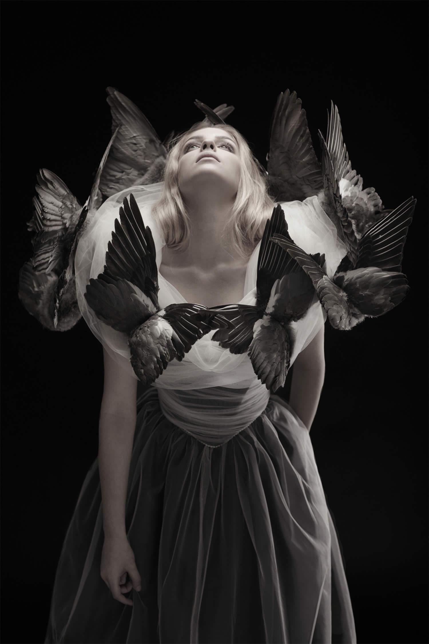 bird wings around blonde girl, roadkill couture