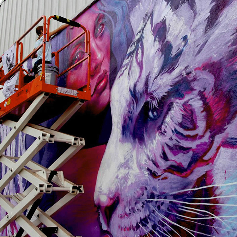 natalia rak working on a mural