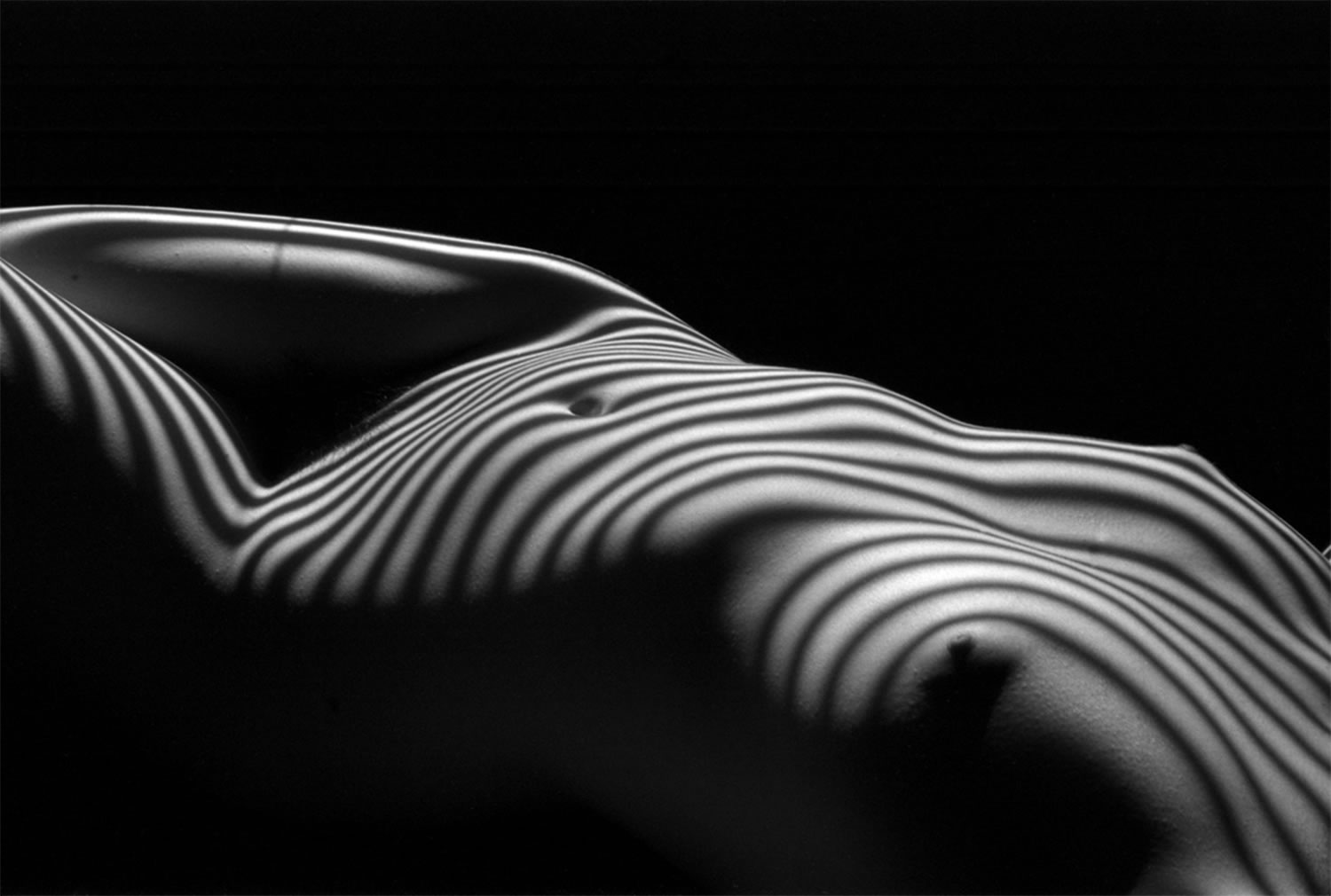 stripes on female body, photo by Lucien Clergue