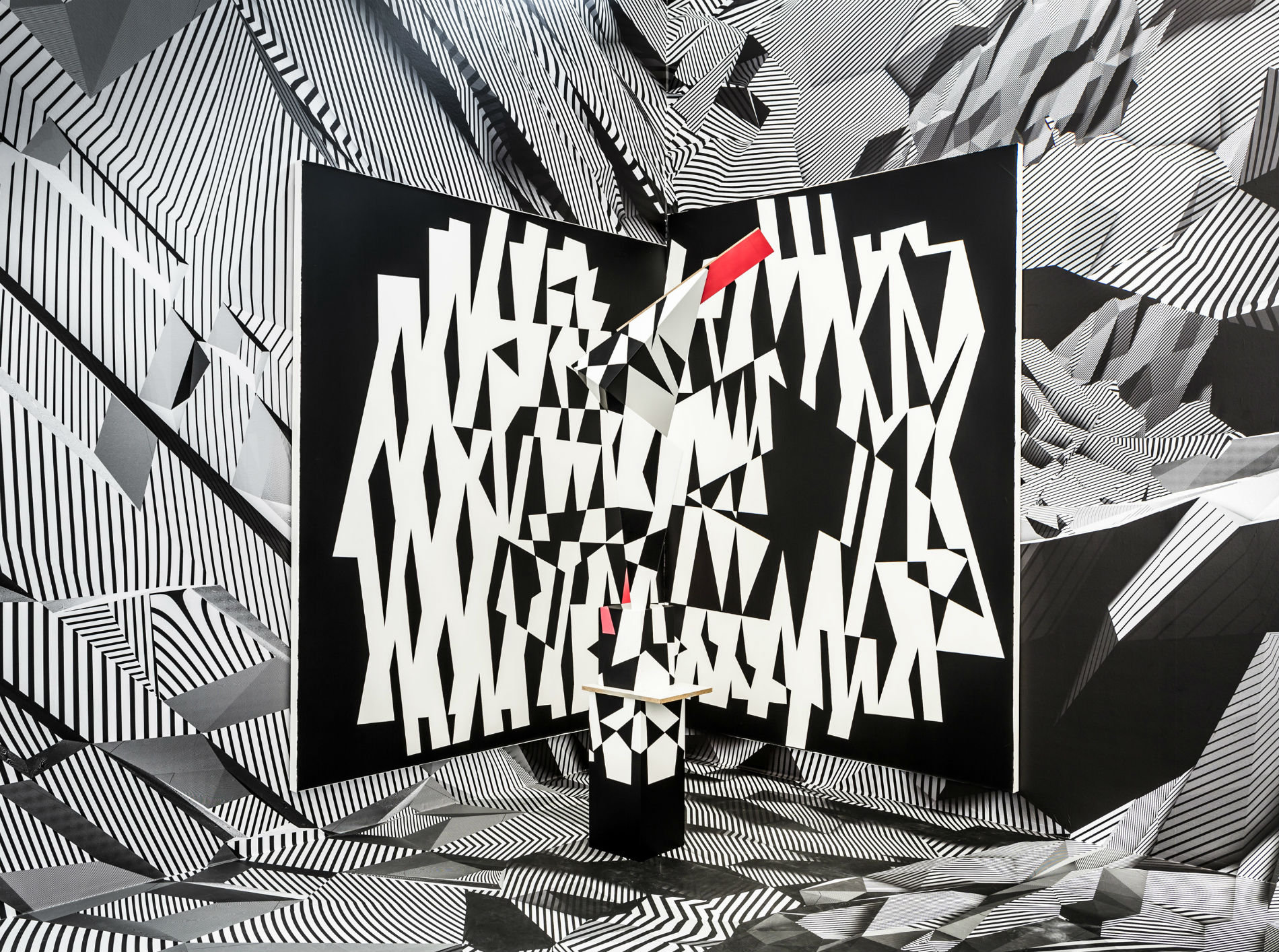 tobias rehberger op art black white installation red