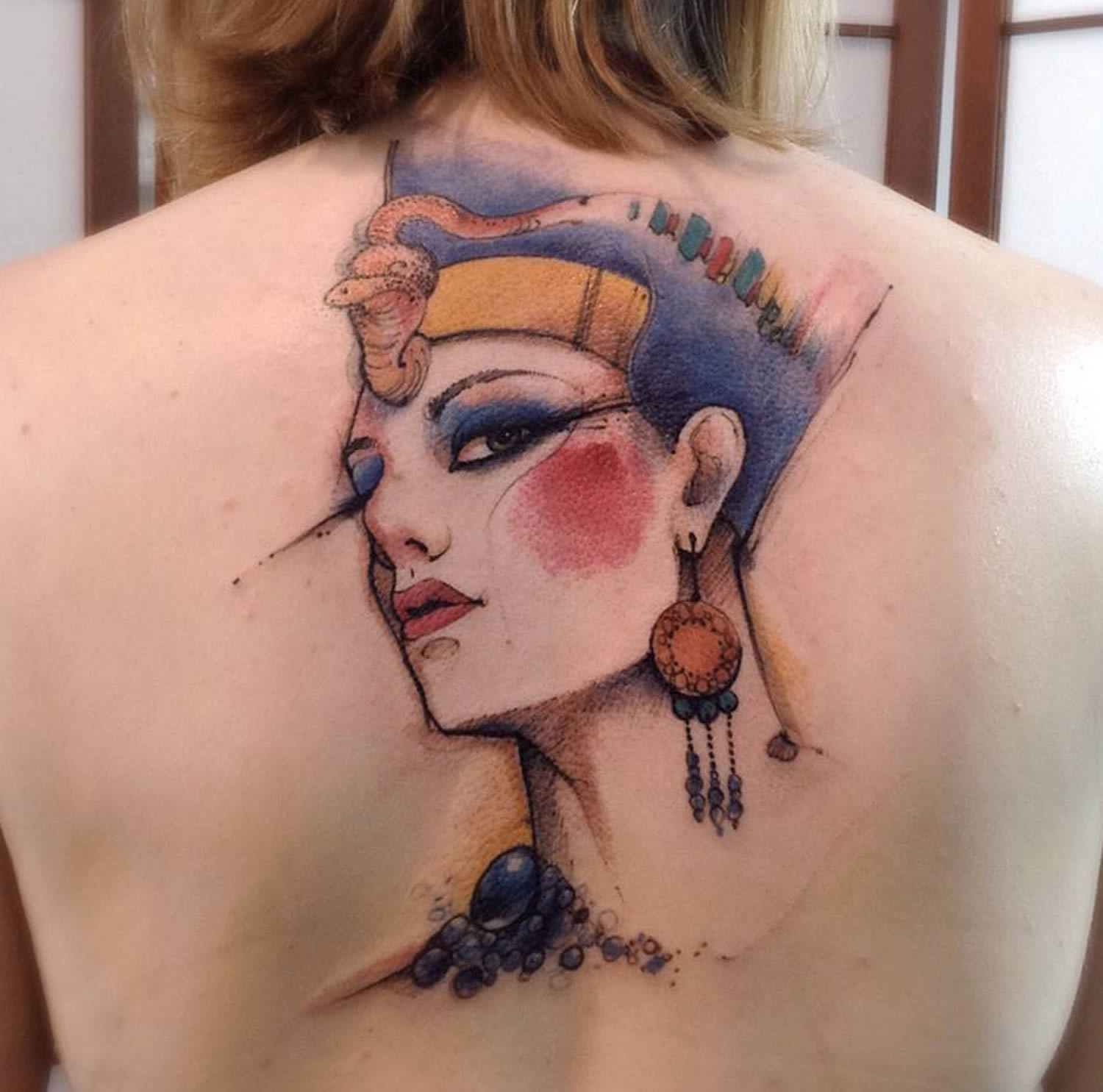 ancient egyptian woman tattoo