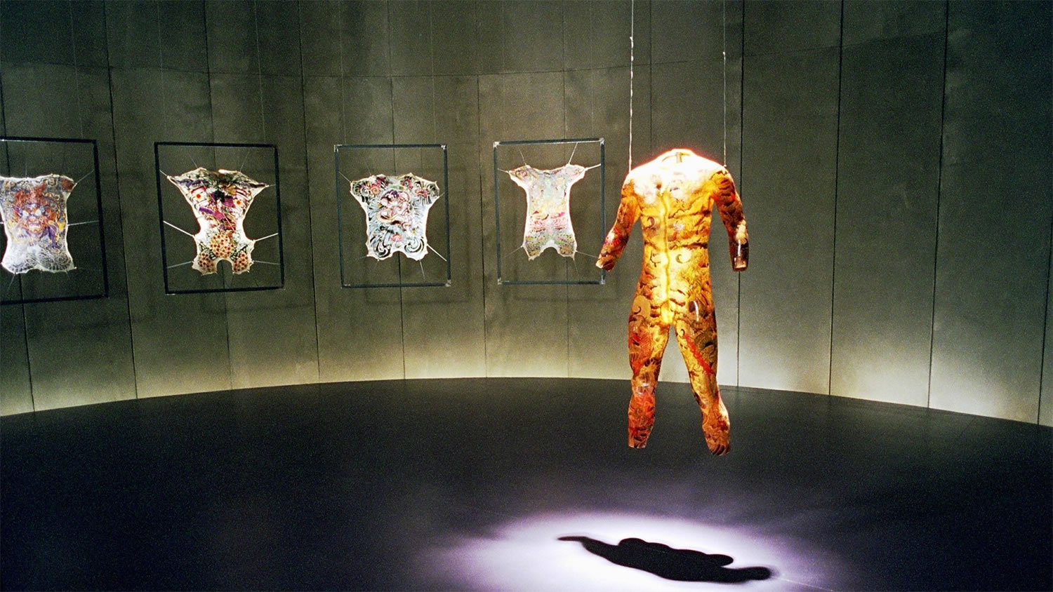 room with skins, and tattoos on those skins, tattoo 2002