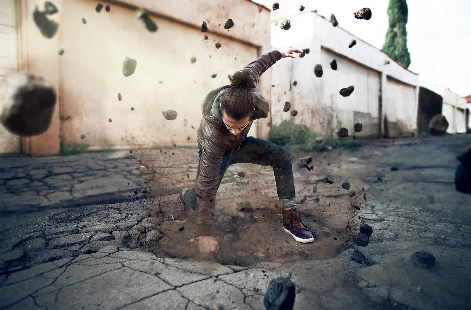 man punching ground, photo by kavan the kid