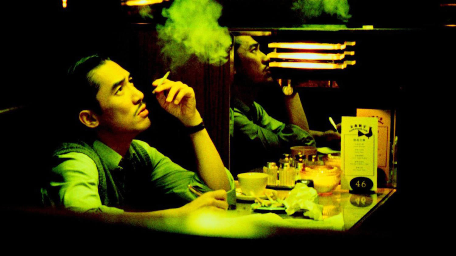 man smoking, yellow neon lighting, 2046 movie