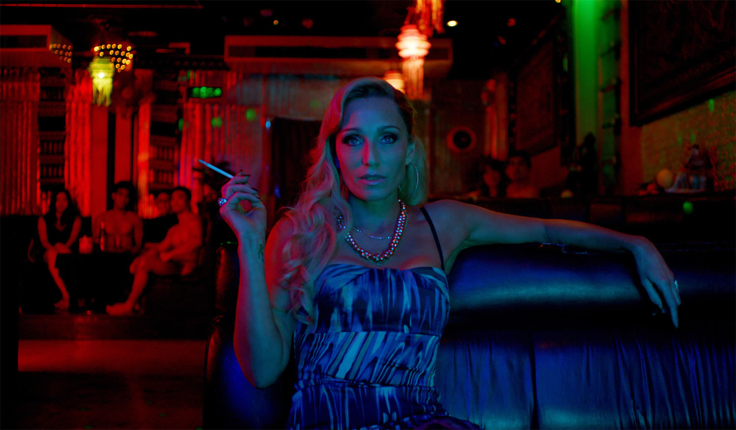 neon lights over kristen scott thomas in Only God Forgives
