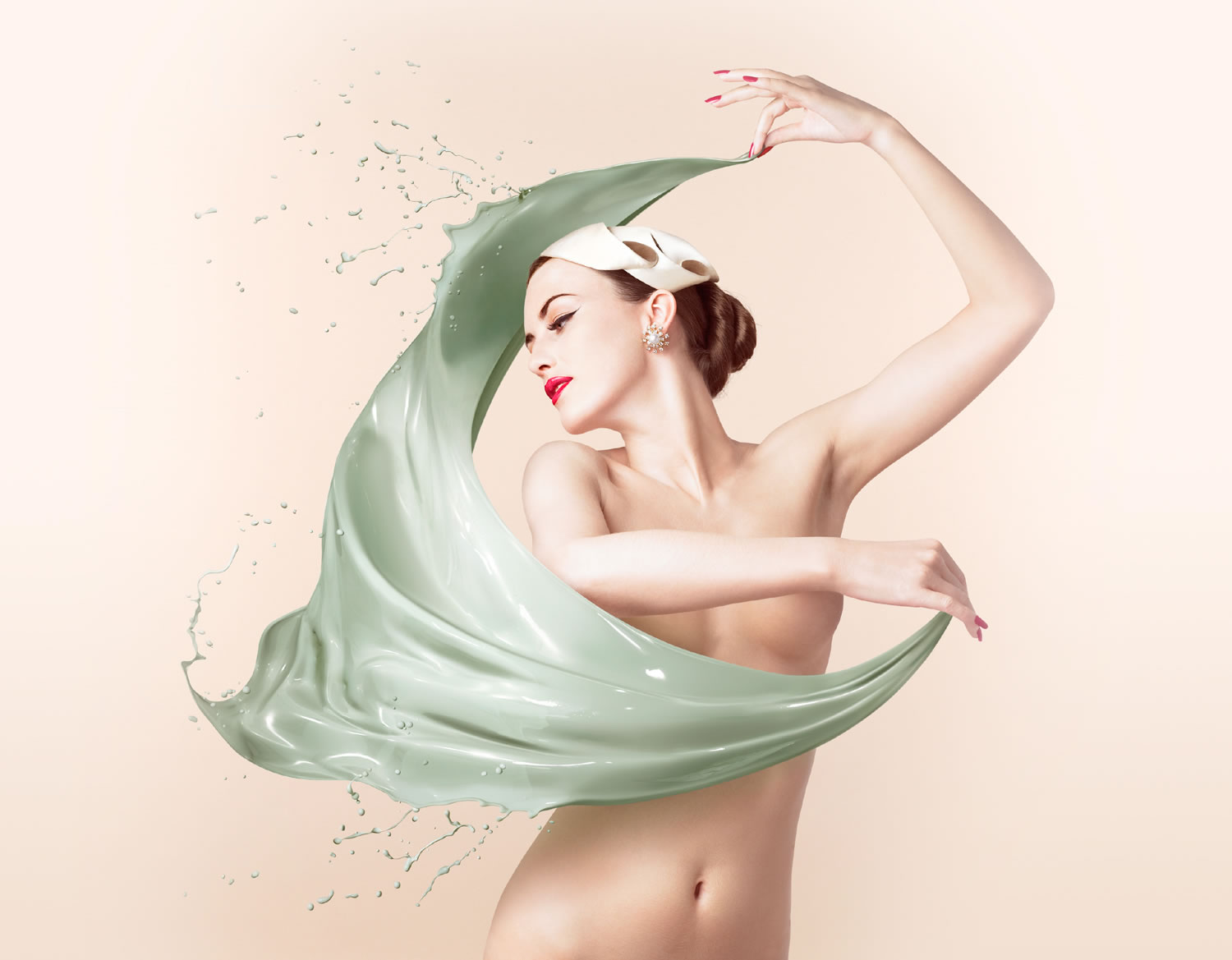 woman swirling paint cloth