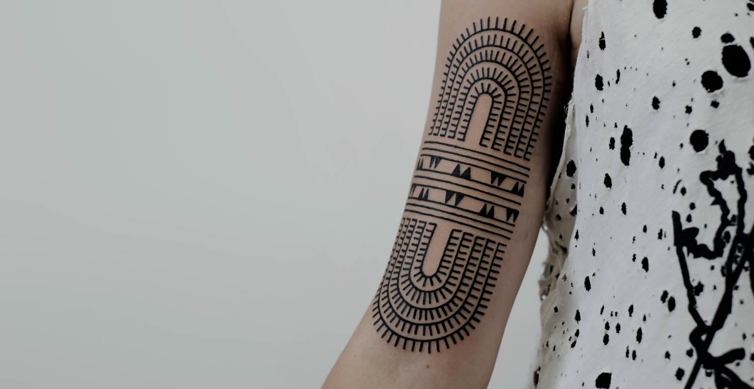 modern tribal on arm, tattoo by victor j webster
