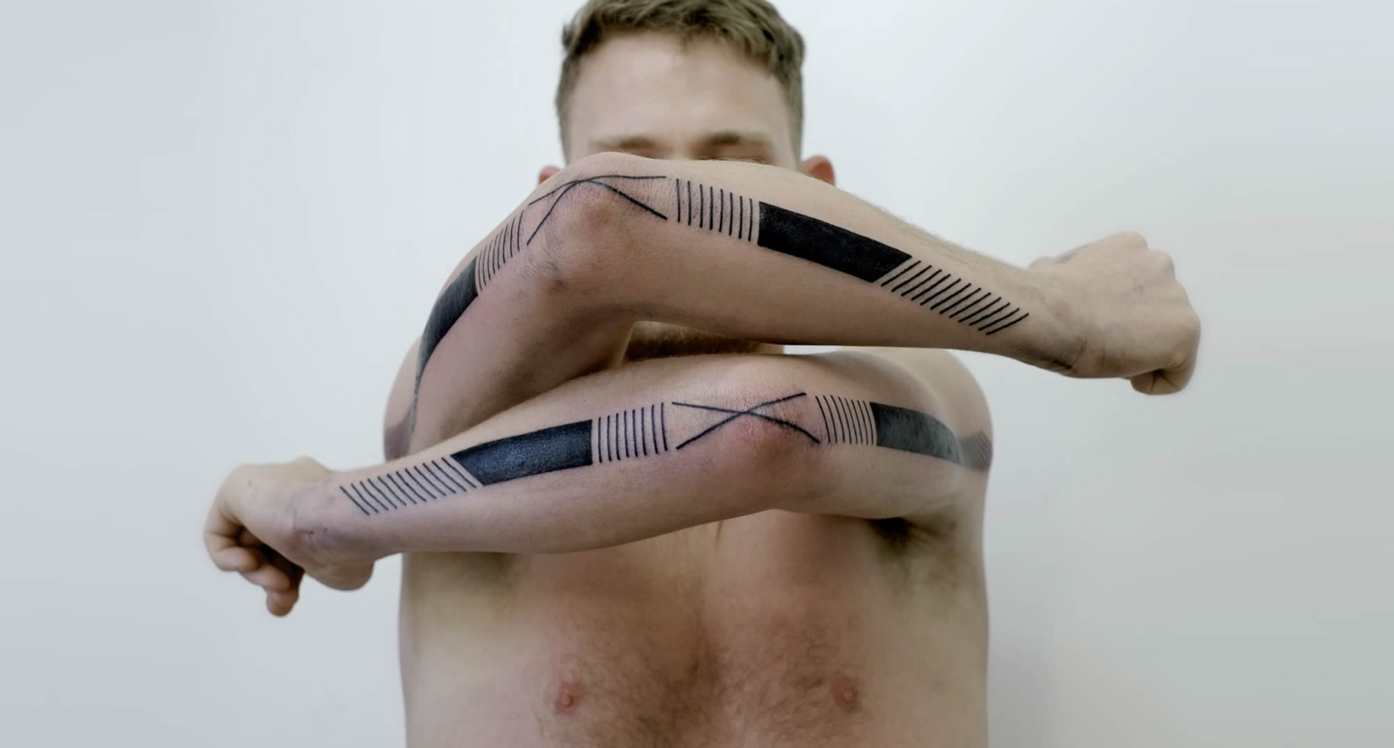 modern tribal tattoo on arms by victor j webster