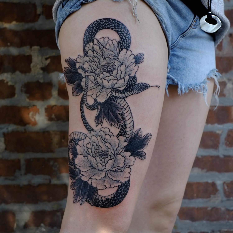 snake and flowers, black ink,by victor j webster