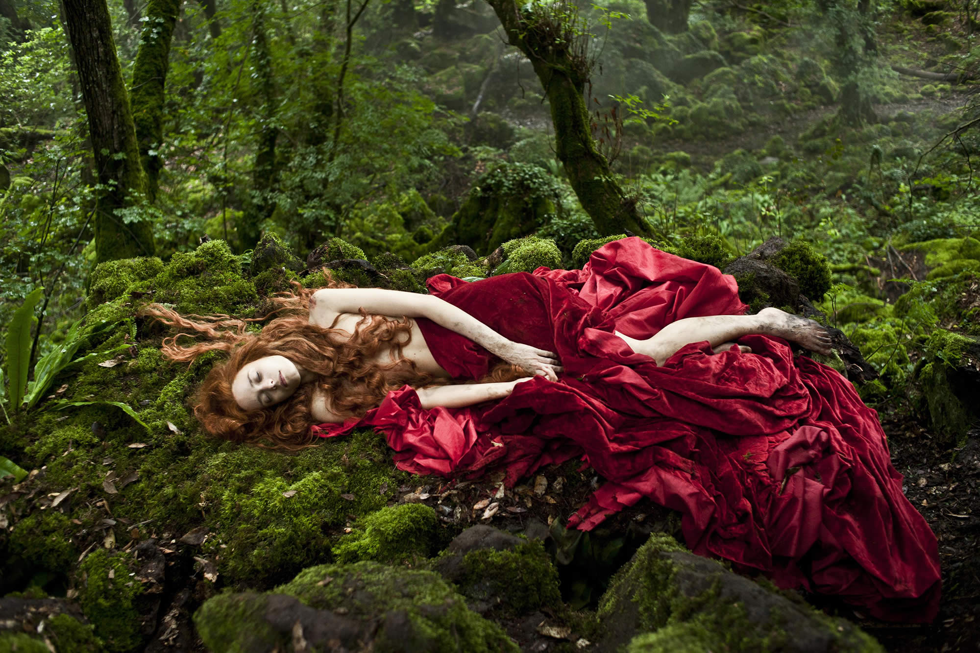 woman in red dress lying on the forest floor, Tale of Tales