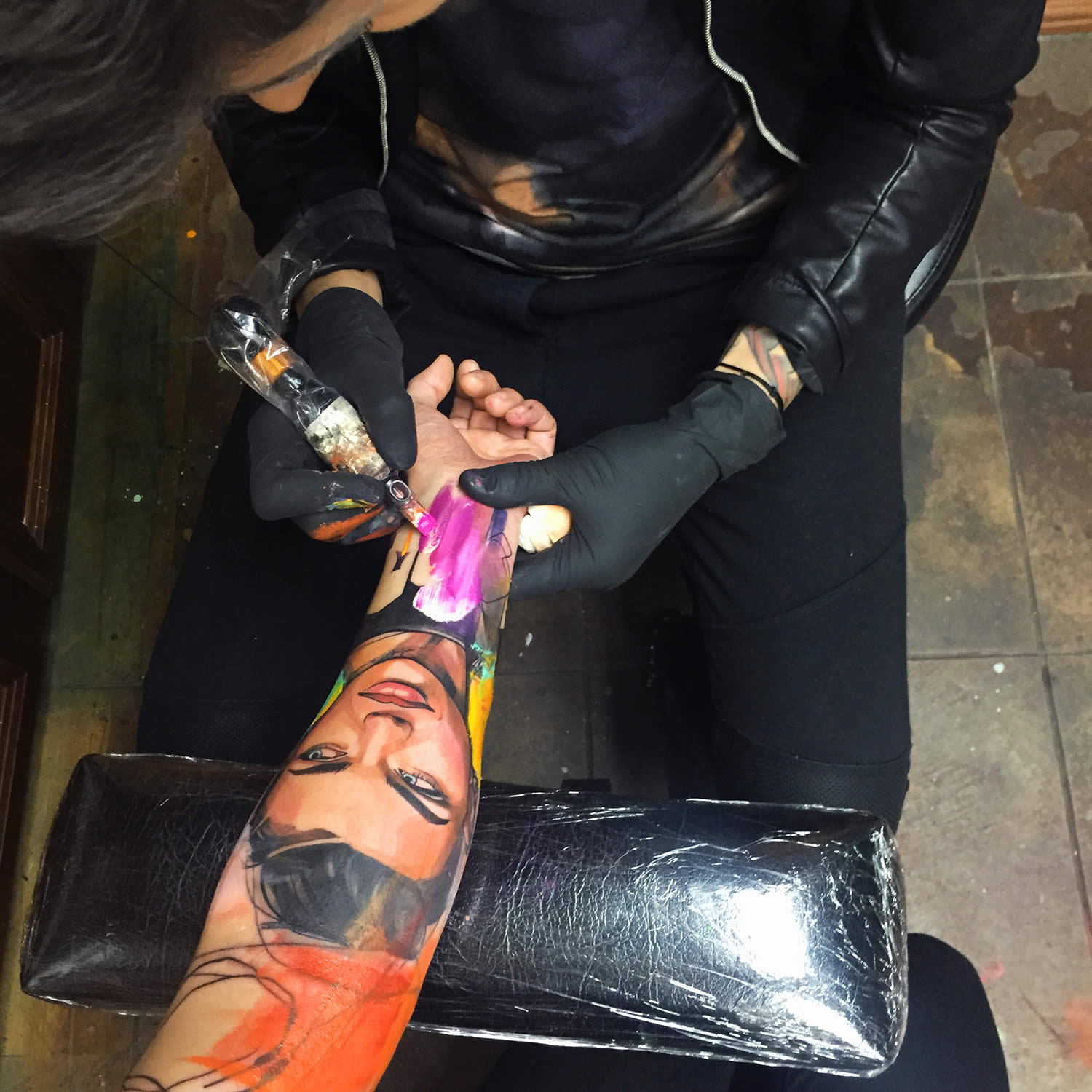 ivana tattooing a client's arm