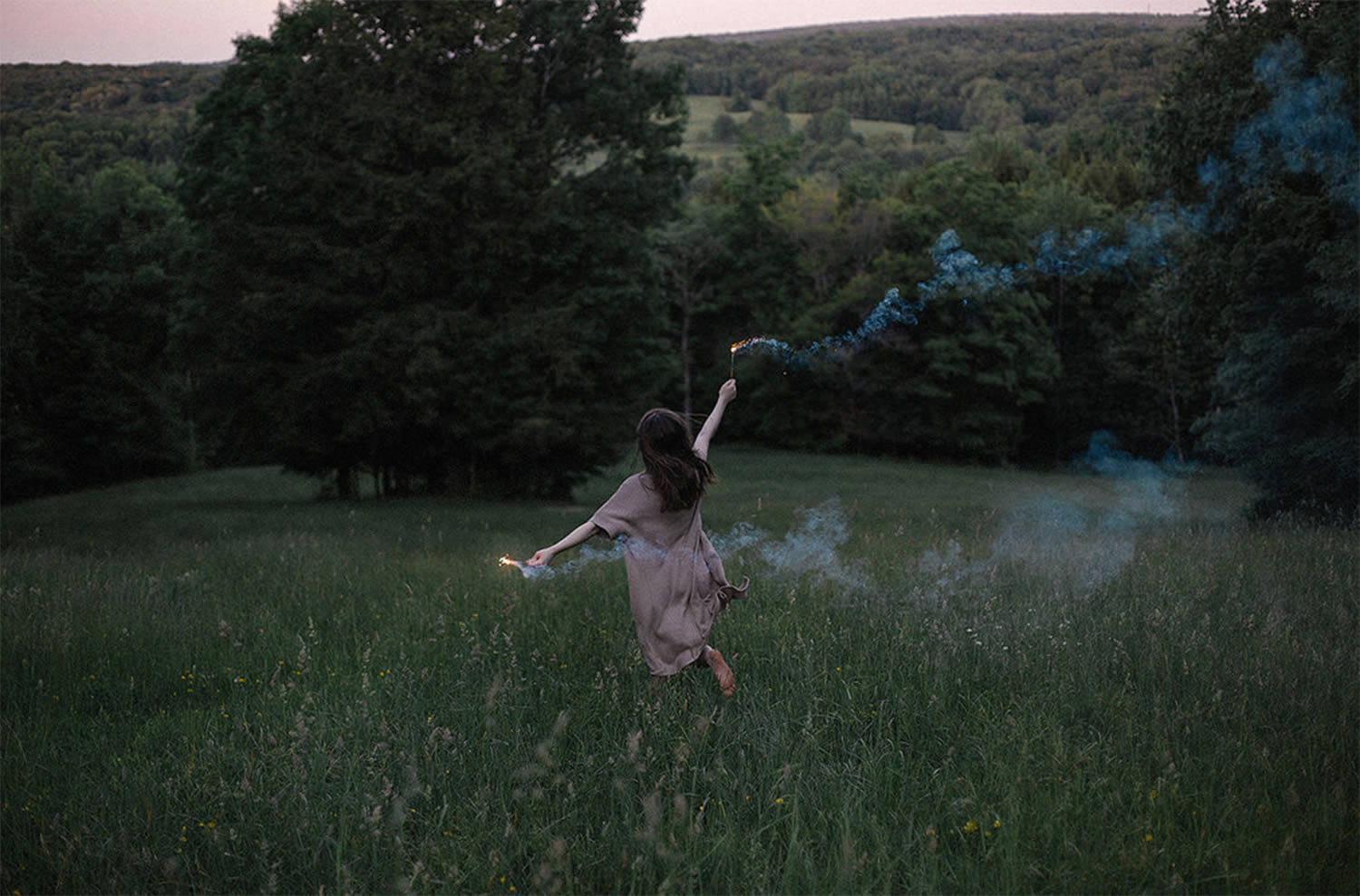 girl running through field, photo by alex currie