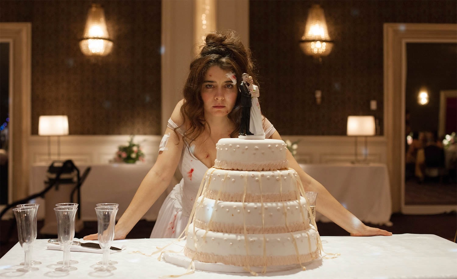 bride in bloody wedding dress and cake. wild tales