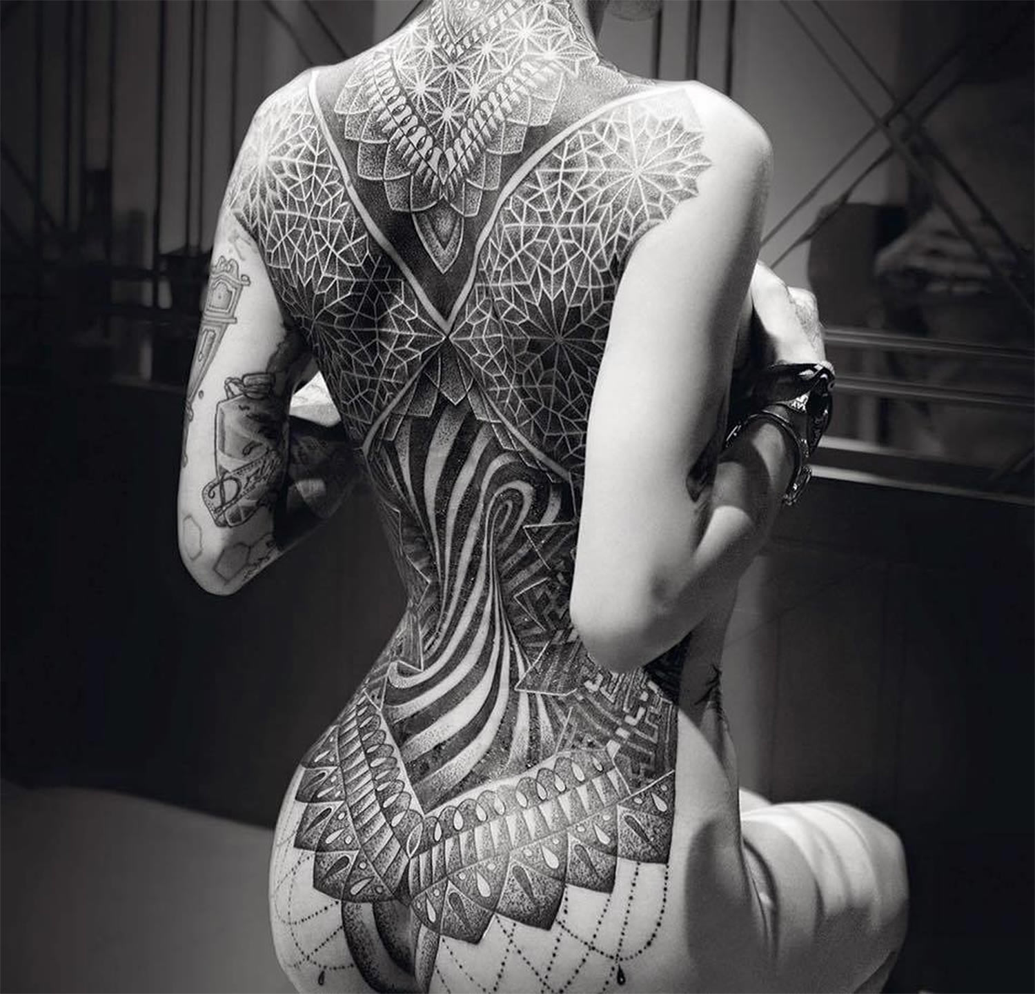 elaborate back tattoo by Glenn W Cuzen