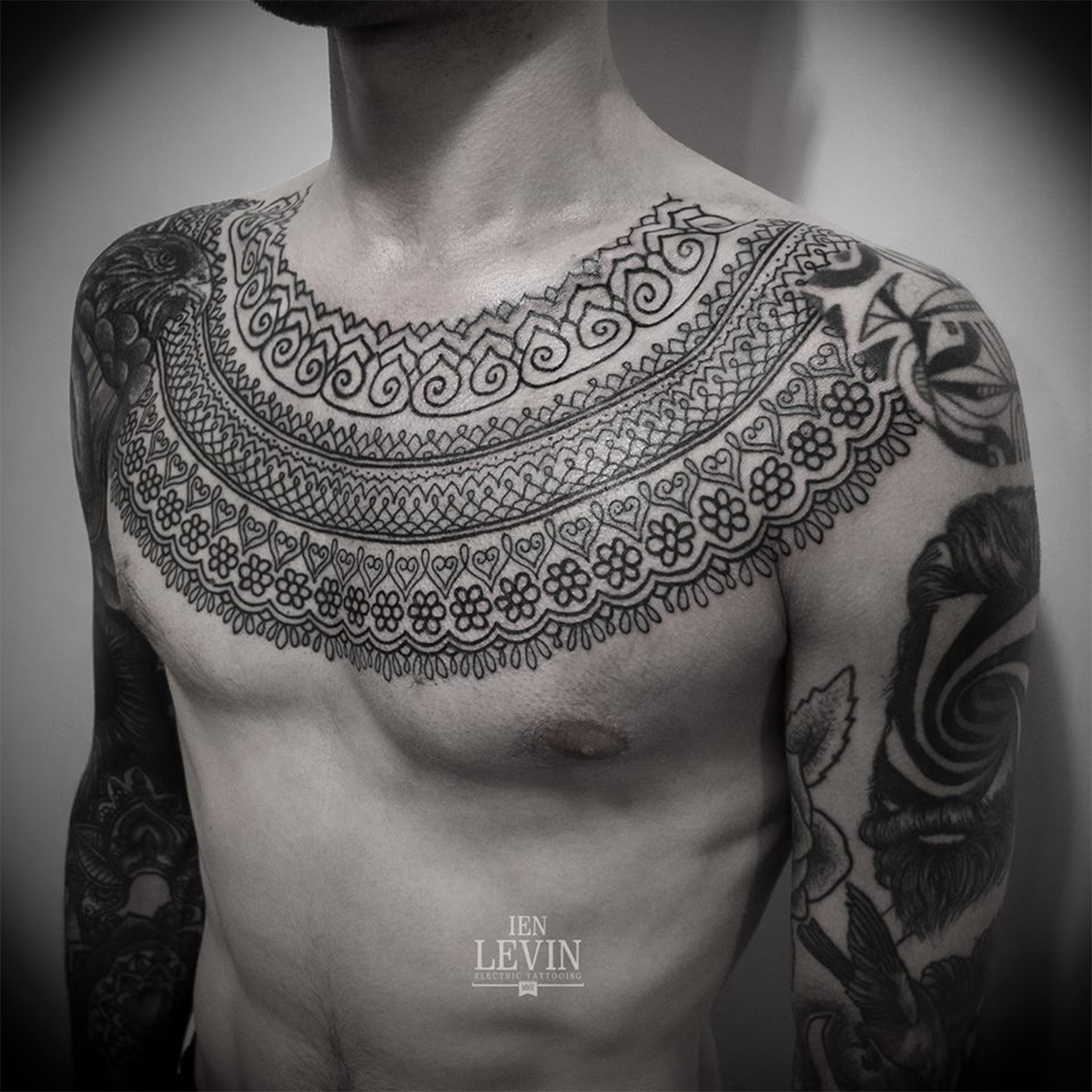 patterned chest tattoo by ien levin