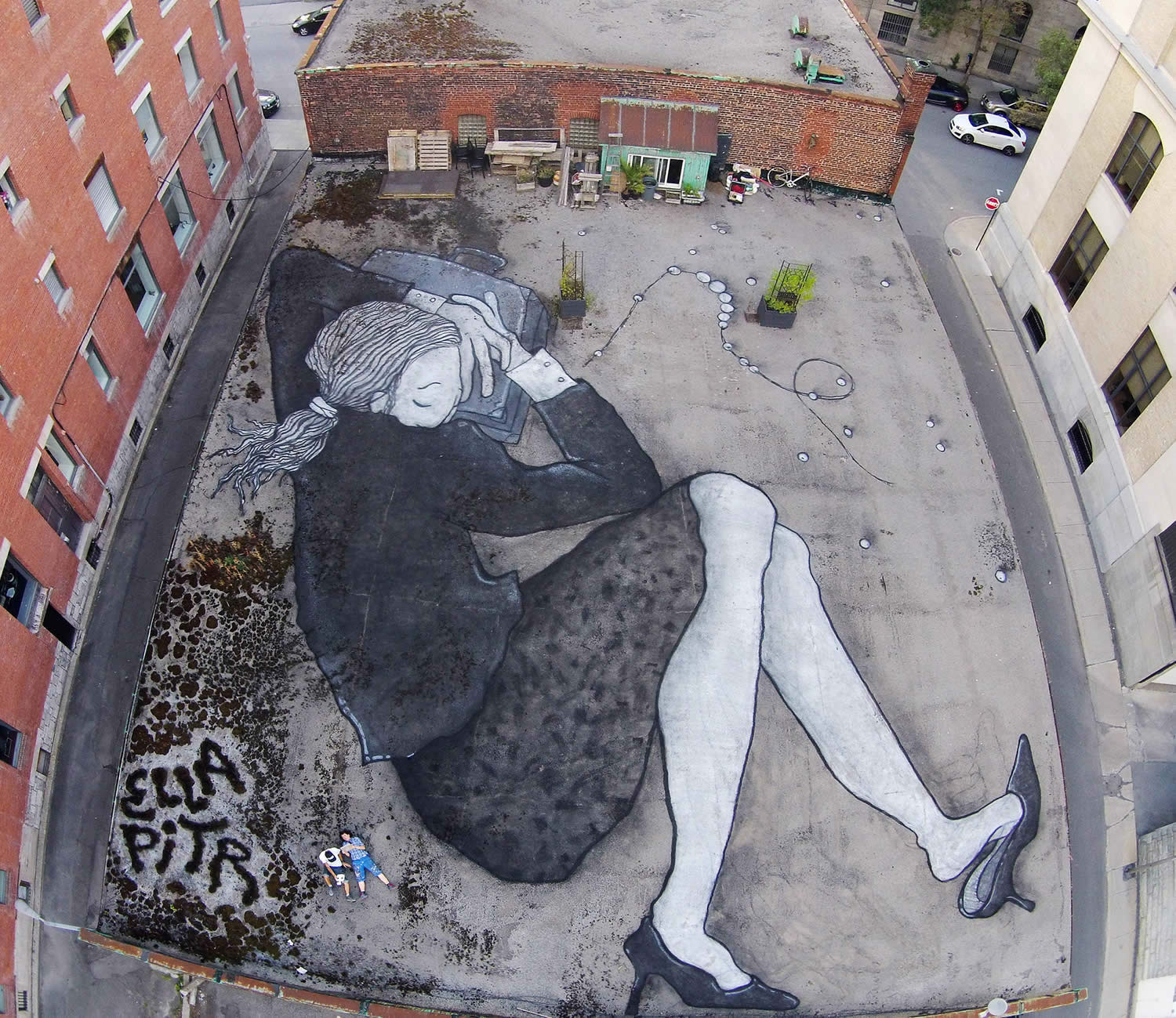 woman sleeping on rooftop, graffiti