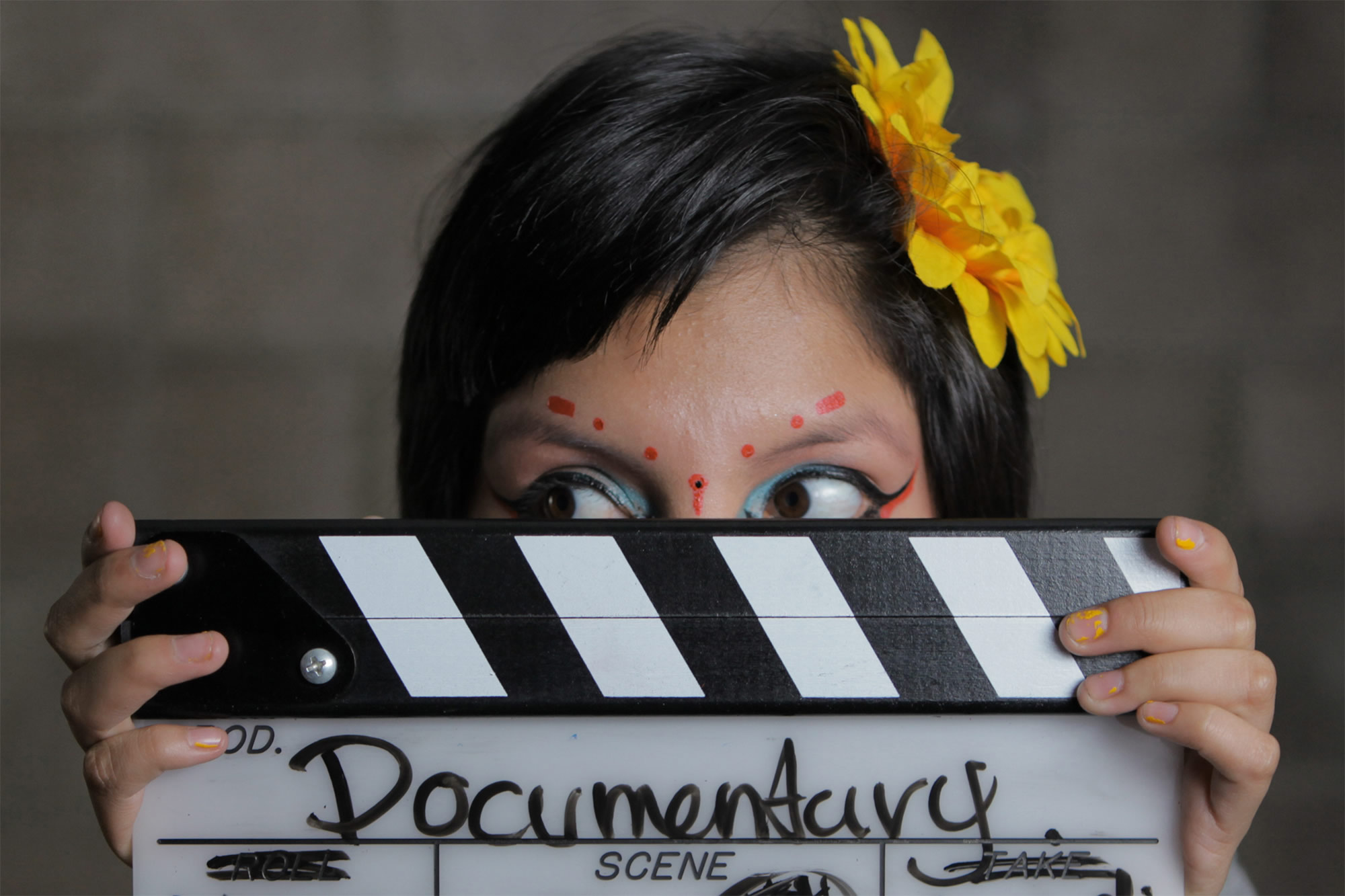 inocente movie, documentary, social good. girl holding film clipboard
