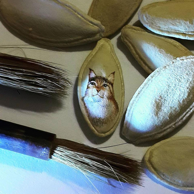cat drawing on pumpkin seed