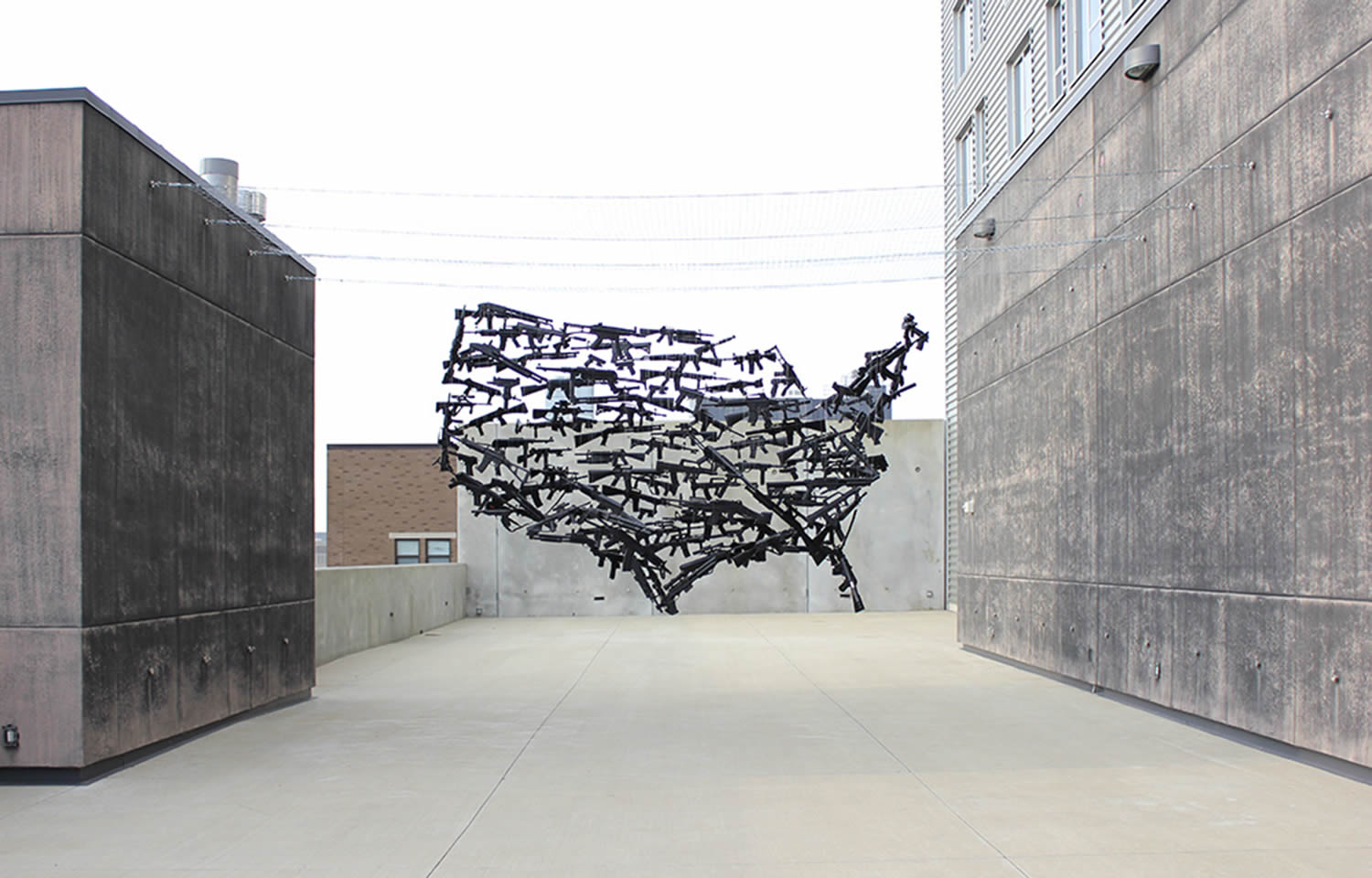 guns form the usa continent,  anamorphic illusion