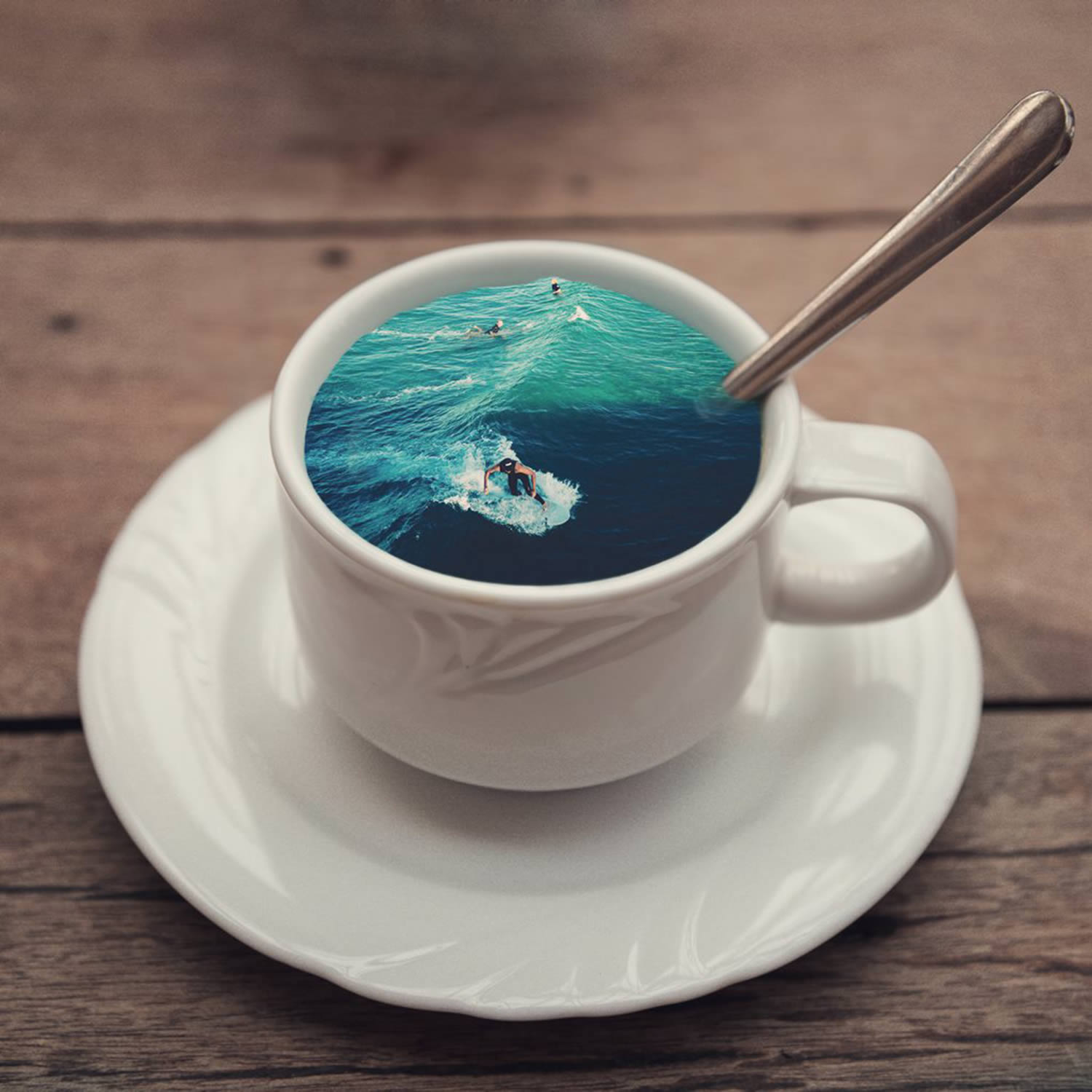 man surfing a wave in a cup
