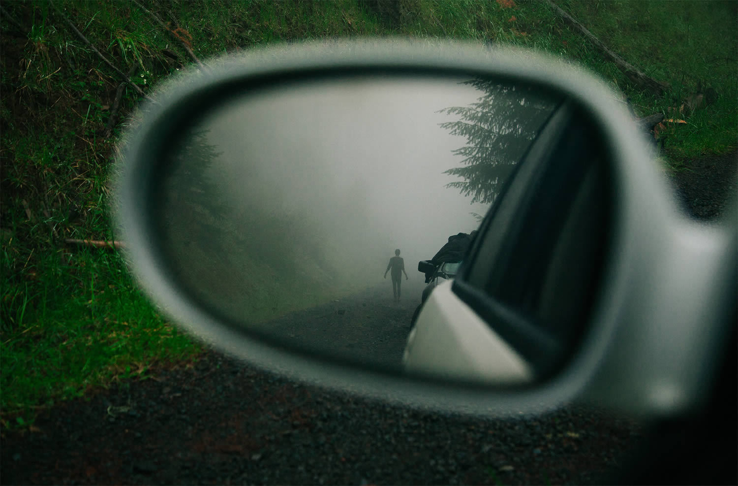 person reflected in car mirror, brendon burton
