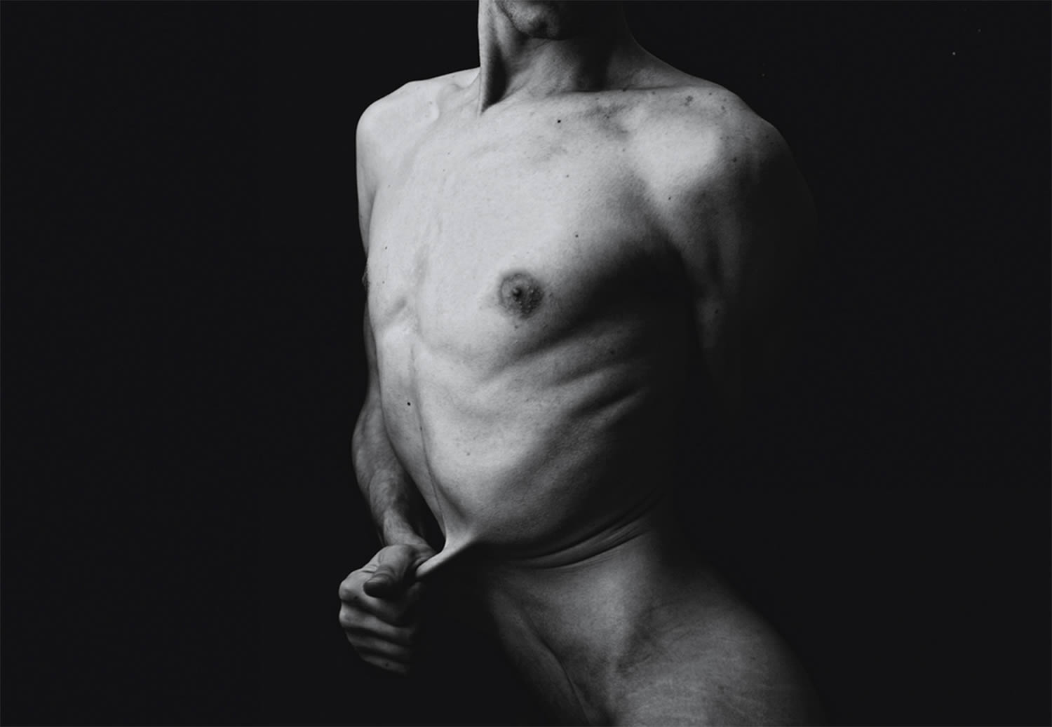 man pulling skin, photography