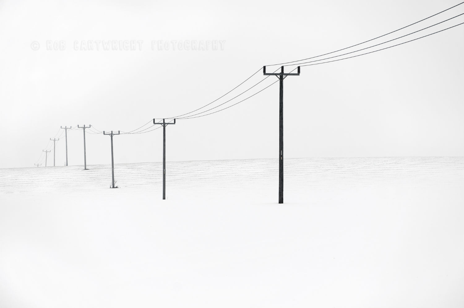 minimalist photography white snow poles