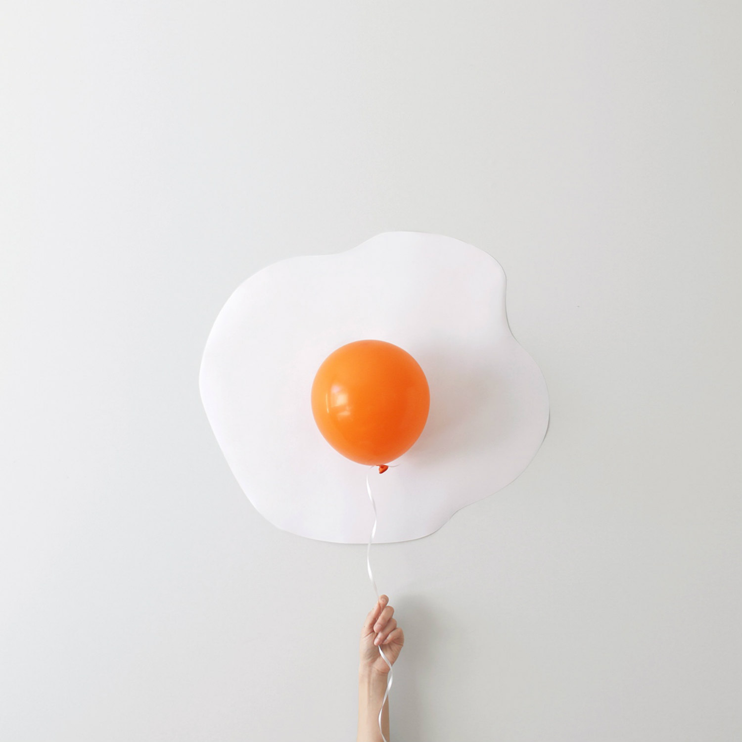 Peechaya Burroughs photography graphic design minimalist objects colour balloon egg