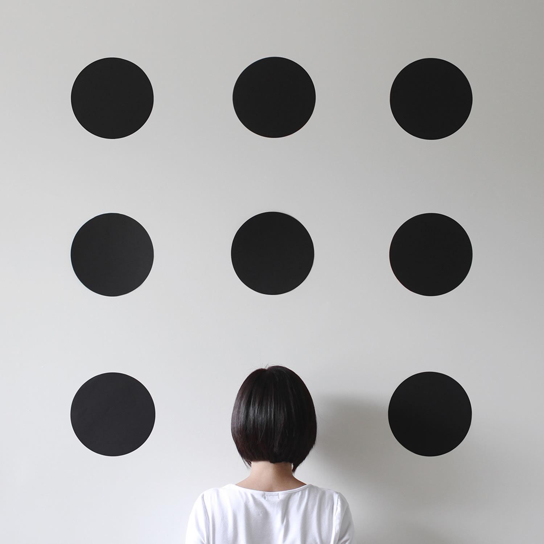 black circles on wall, Peechaya Burroughs