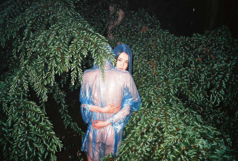 girl hugging man in forest