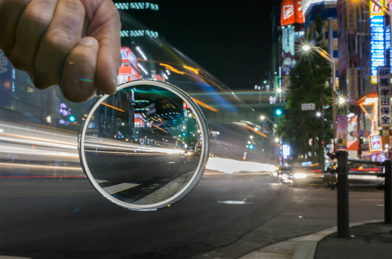 city lights, japan, magnify glass