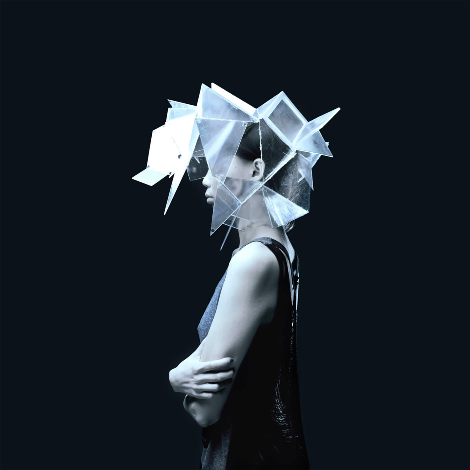 sculptural head piece on woman, by thibault-delhom