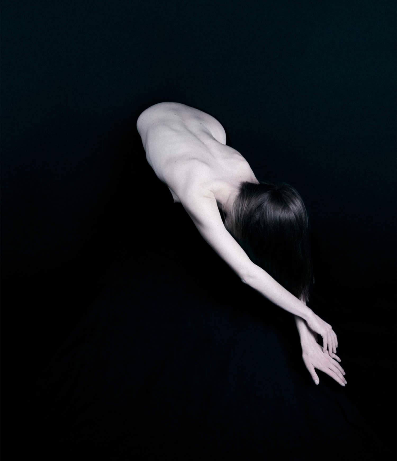 black background, woman stretching, thibault-delhom
