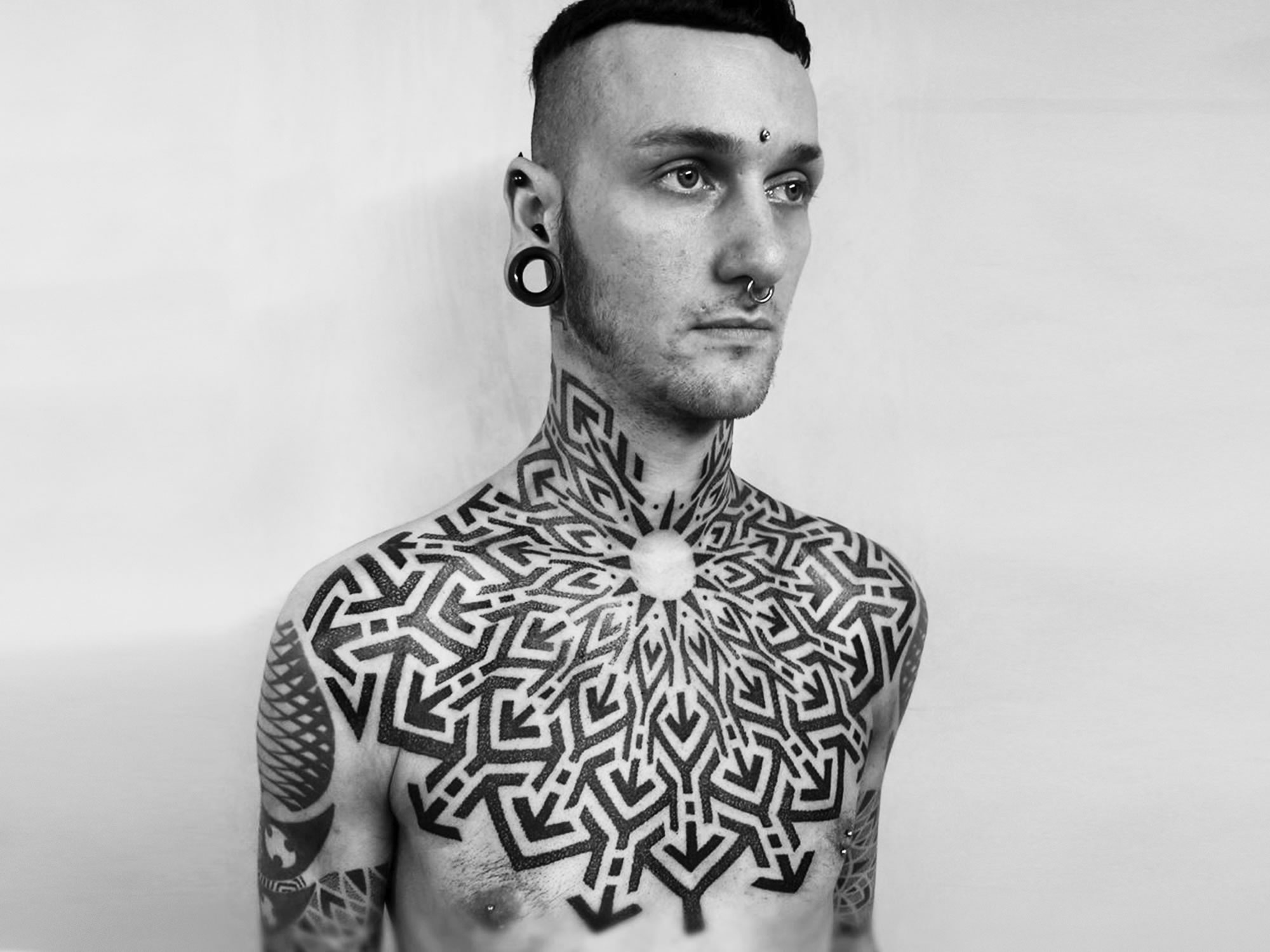 Striking Geometric Blackwork by Tomas Tomas